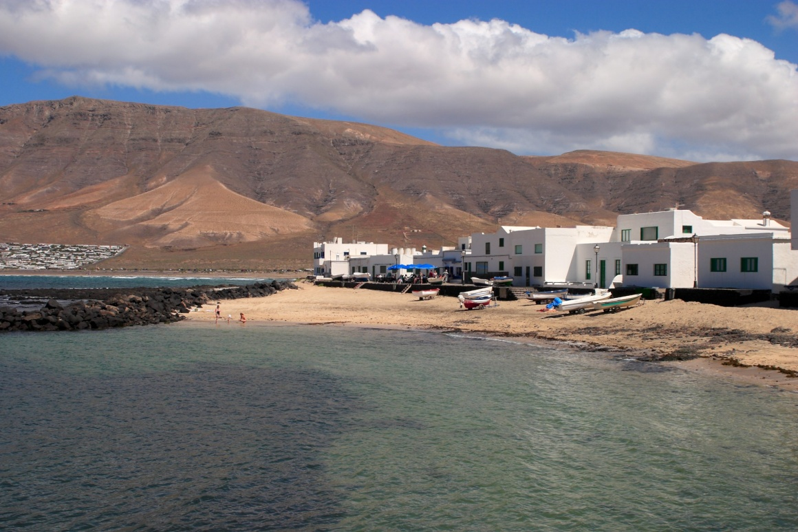 'Spain Canary Islands Lanzarote village of whitewashed houses overlooking Famara Beach' - Lanzarote